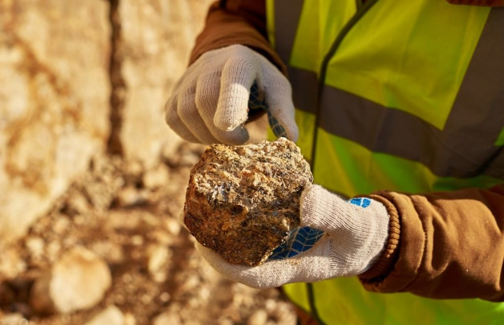 What Is Rock Hunting? - A man holding a rock that he has found